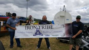 Iron Tribe Network Banner held up by three members