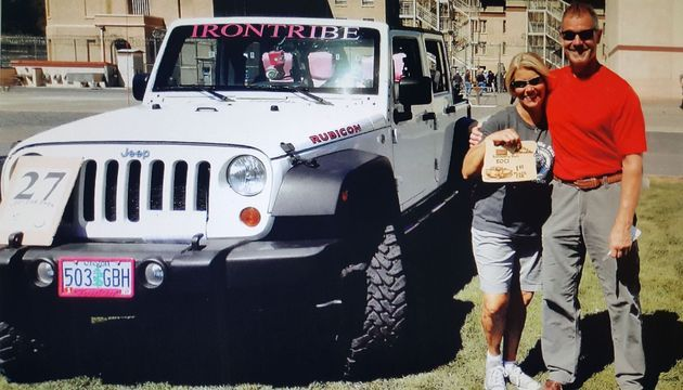 Photo of Reina Bower with 1st Place Car Award at an in-reach event, Car & Bike Show, at Eastern Oregon Correctional Institution in Pendleton, OR