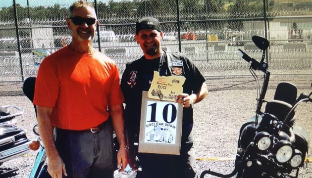 Photo of Shawn Bower with 1st Place Bike Award at an in-reach event, Car & Bike Show, at Eastern Oregon Correctional Institution in Pendleton, OR
